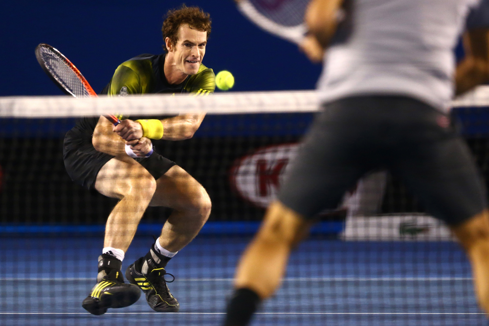 Description of . Britain's Andy Murray makes a backhand return during his semifinal win over Switzerland's Roger Federer at the Australian Open tennis championship in Melbourne, Australia, Friday, Jan. 25, 2013. (AP Photo/Mark Kolbe,Pool)