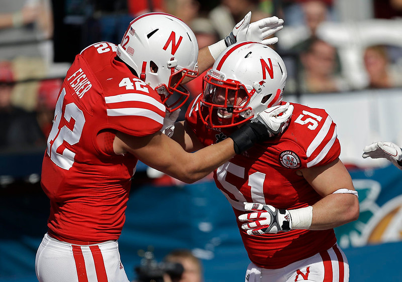 . Nebraska linebacker Sean Fisher (42) congratulates teammate linebacker Will Compton (51) after Compton intercepted a Georgia pass for a touchdown during the first half of the Capital One Bowl NCAA football game, Tuesday, Jan. 1, 2013, in Orlando, Fla. (AP Photo/John Raoux)