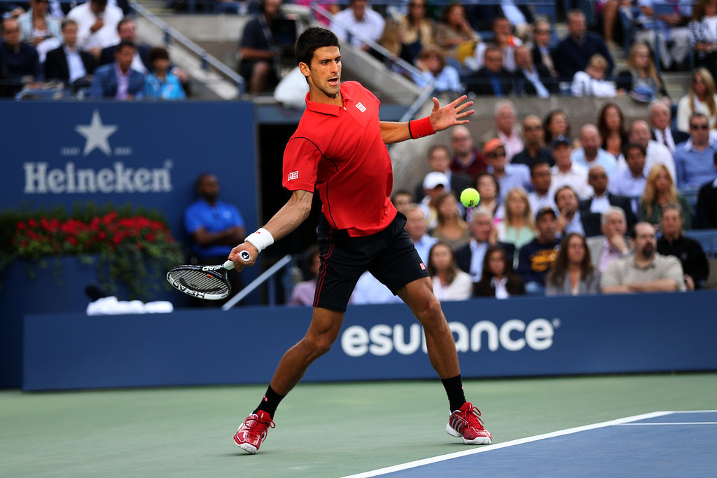 . Novak Djokovic of Serbia plays a forehand during his men\'s singles final match against Rafael Nadal of Spain on Day Fifteen of the 2013 US Open at the USTA Billie Jean King National Tennis Center on September 9, 2013 in the Flushing neighborhood of the Queens borough of New York City.  (Photo by Clive Brunskill/Getty Images)