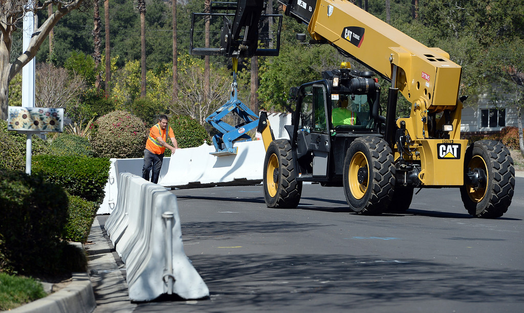 . Glendora residents fill sand bags at the city yard Tuesday February 25, 2014 while public works crews place concrete barriers to divert possible water and flood flows on Sierra Madre Aveune, Brown Sage Drive and Leose Lane. Possible heavy rains in the coming days could create mud flows off of the burned hill sides caused by January\'s Colby Fire. (Will Lester/Inland Valley Daily Bulletin)