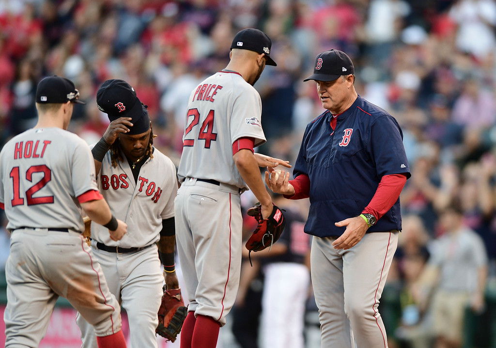 . Boston Red Sox manager John Farrell, right, takes the ball from pitcher David Price (24) in the fourth inning during Game 2 of baseball\'s American League Division Series against the Cleveland Indians, Friday, Oct. 7, 2016, in Cleveland. (AP Photo/David Dermer)