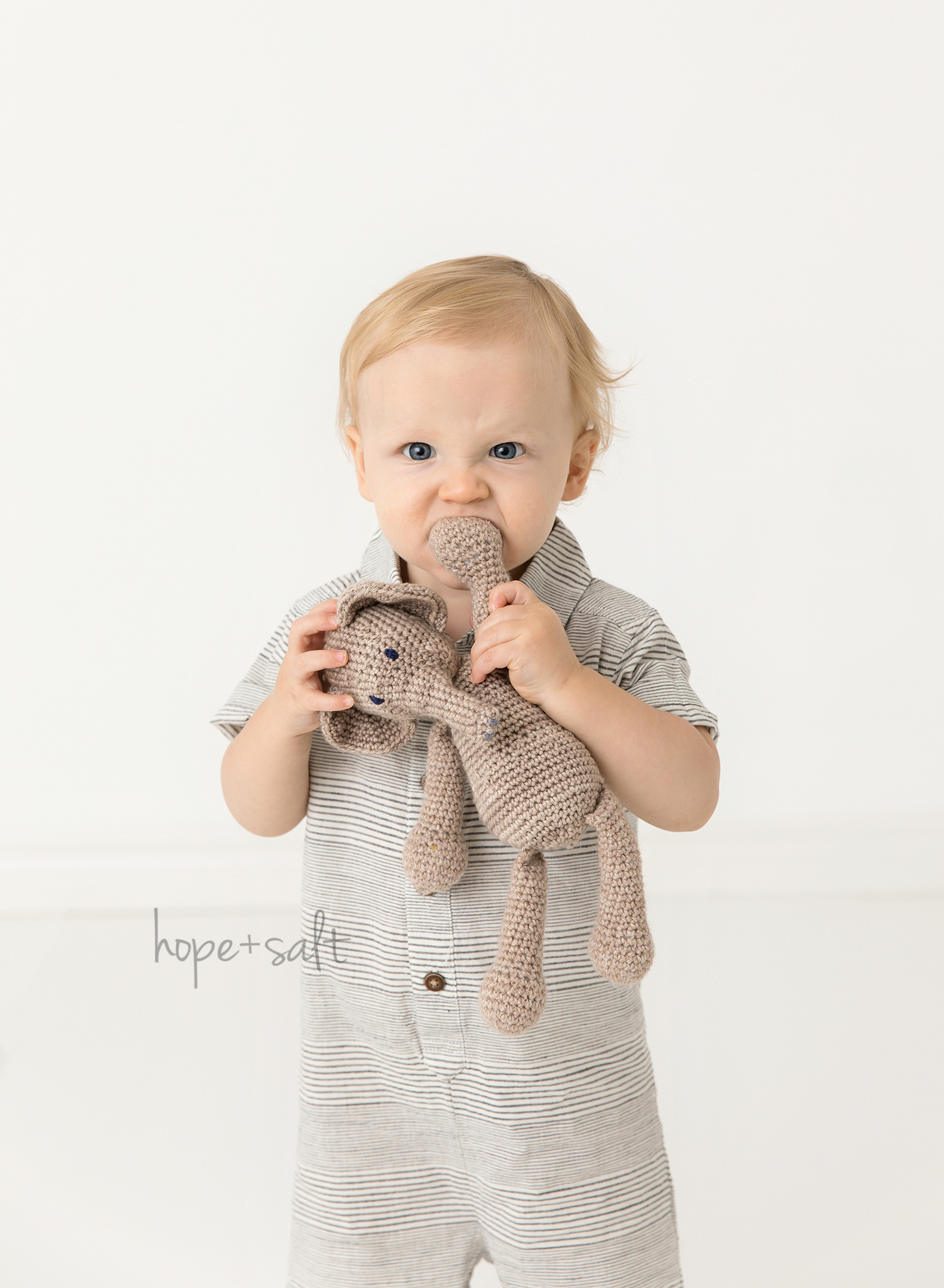 first birthday studio session for one year old boy Braden in candid natural all whites style by Burlington Ontario Canada baby Photographer hope and salt including his elephant stuffed animal lovie
