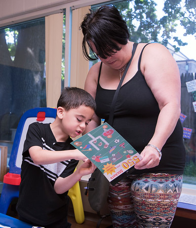 08/23/18 Wesley Bunnell | Staff The New Britain Youth Museum held a back to school party featuring activities, prizes and New Britain Bees mascot Sting on Thursday afternoon. Shaun Baldwin, age 7, picks out stickers for his school folder with the help of Glenda Morales.