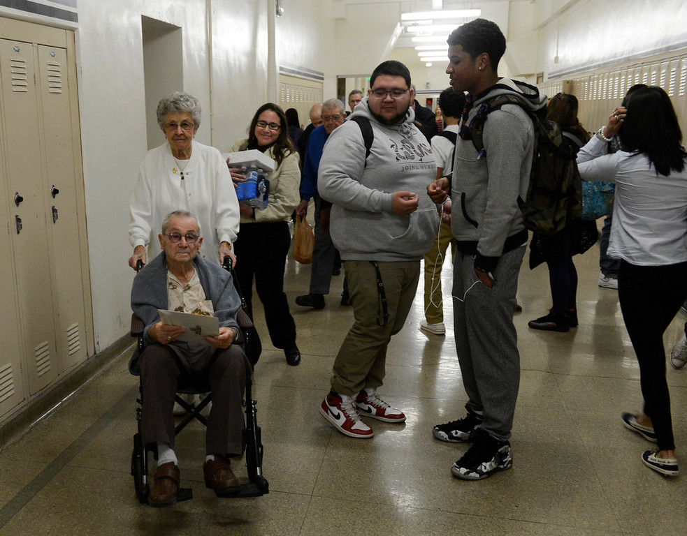 . Irene Haberman wheels her husband, WWII veteran, Harold Haberman, through the halls of South High School on their way to a question and answer session with U.S. History students at South High Wednesday morning, February 12, 2014. (Photo By Andy Cross / The Denver Post)
