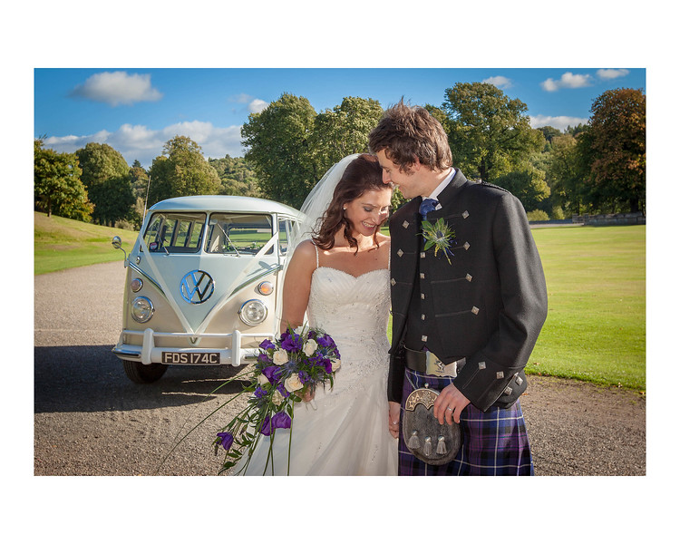 Wedding Photography of Laura & Barry, Callander House in Callander Park, Falkirk, Photograph is of the Bride & Groom standing in the sun in front of a vintage Volkswagan campervan