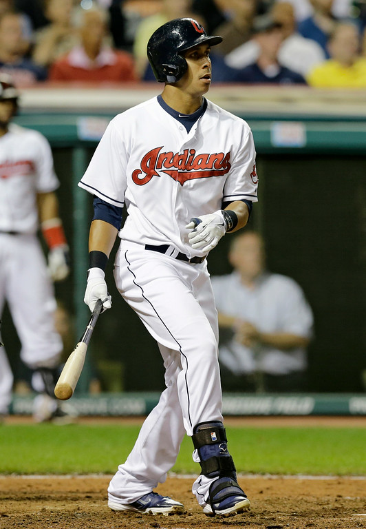 . Cleveland Indians\' Michael Brantley hits an RBI-single off Detroit Tigers relief pitcher Pat McCoy in the seventh inning of a baseball game, Wednesday, Sept. 3, 2014, in Cleveland. Jose Ramirez scored on the play. The Indians defeated the Tigers 7-0. (AP Photo/Tony Dejak)