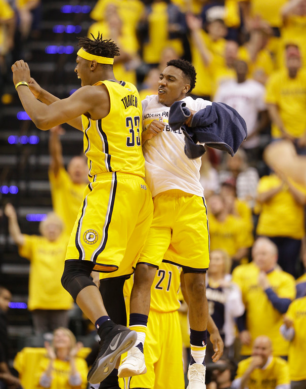 . Indiana Pacers\' Myles Turner reacts with Jeff Teague during the first half in Game 3 of a first-round NBA basketball playoff series against the Cleveland Cavaliers, Thursday, April 20, 2017, in Indianapolis. (AP Photo/Michael Conroy)
