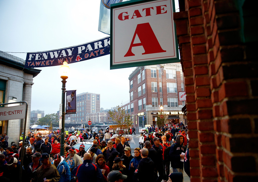 . BOSTON, MA - OCTOBER 12:  Fans walk outside Fenway Park before Game One of the American League Championship Series between the Boston Red Sox and the Detroit Tigers on October 12, 2013 in Boston, Massachusetts.  (Photo by Jared Wickerham/Getty Images)