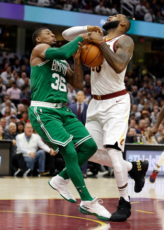 . Boston Celtics\' Marcus Smart (36) knocks the ball loose from Cleveland Cavaliers\' LeBron James (23) in the second half of an NBA basketball game, Tuesday, Oct. 17, 2017, in Cleveland. (AP Photo/Tony Dejak)