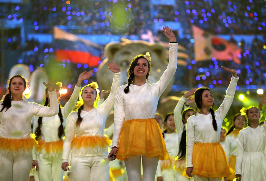 . epa04098269 Performers wave during the Closing Ceremony in Fisht Olympic Stadium at the Sochi 2014 Olympic Games, Sochi, Russia, on Feb. 23, 2014.  EPA/TATYANA ZENKOVICH