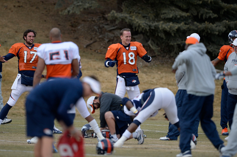 . Denver Broncos quarterback Peyton Manning (18) stretches before practice January 15, 2014 at Dove Valley. The Broncos are preparing for their game against the New England Patriots in the AFC championship game.  (Photo by John Leyba/The Denver Post)