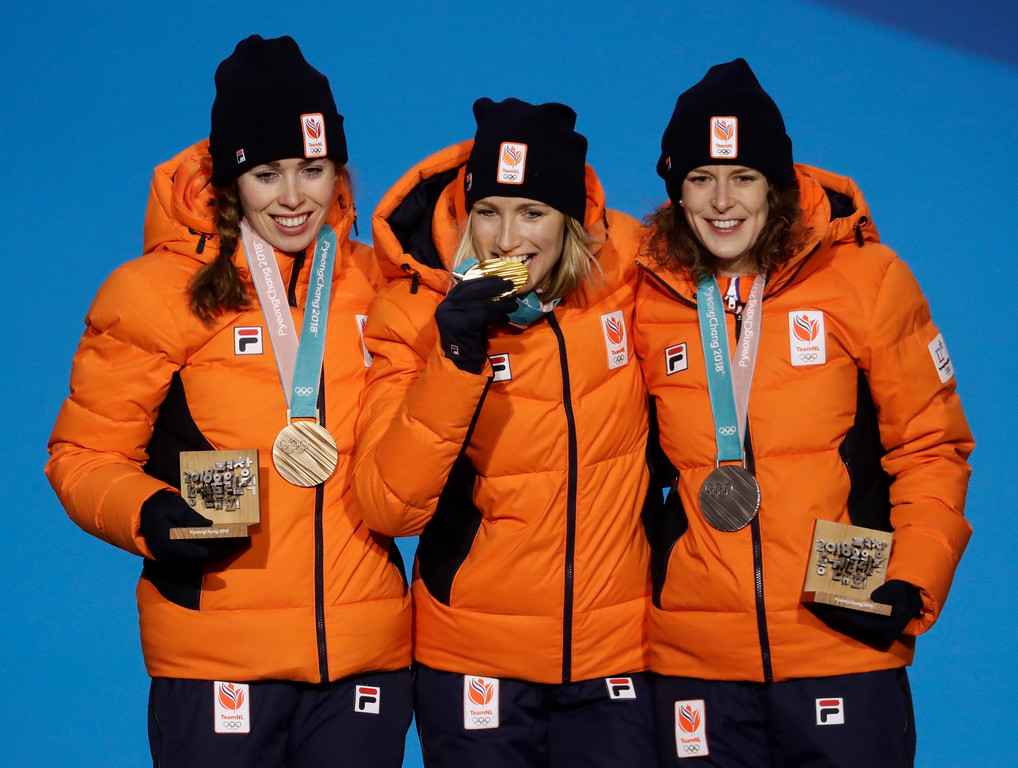 . Women\'s 3,000 meter speedskating medalists, from left, the Netherlands\' Ireen Wust, silver, Carlijn Achtereekte, gold, and Antoinette de Jong, bronze pose during their medals ceremony at the 2018 Winter Olympics in Pyeongchang, South Korea, Sunday, Feb. 11, 2018. (AP Photo/Morry Gash)