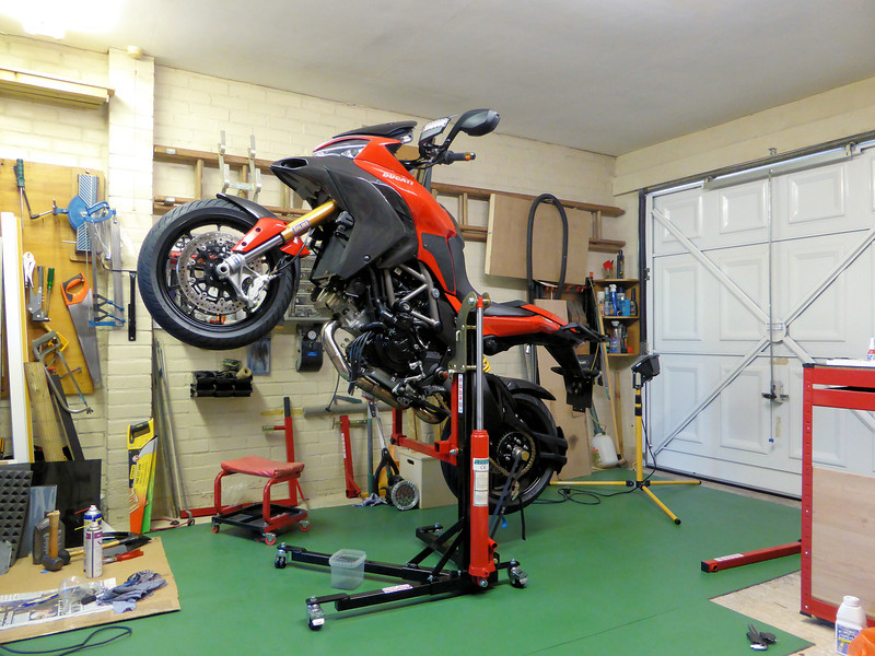 Flying wheelie for the Multistrada 1200! As great as the Bursig Lift Stand is I couldn't pass up the chance to upgrade to the Abba Sky Lift - what an amazing bit of kit, any service, maintenance or 'anal' cleaning task (lol) has never been so easy (NB: three lift positions - horizontal, 'wheelie' and 'stoppie' ;-) See here:  http://andyw-inuk.smugmug.com/Motorcycles/Ducati-Multistrada-1200/Abba-Motorcycle-Equipment