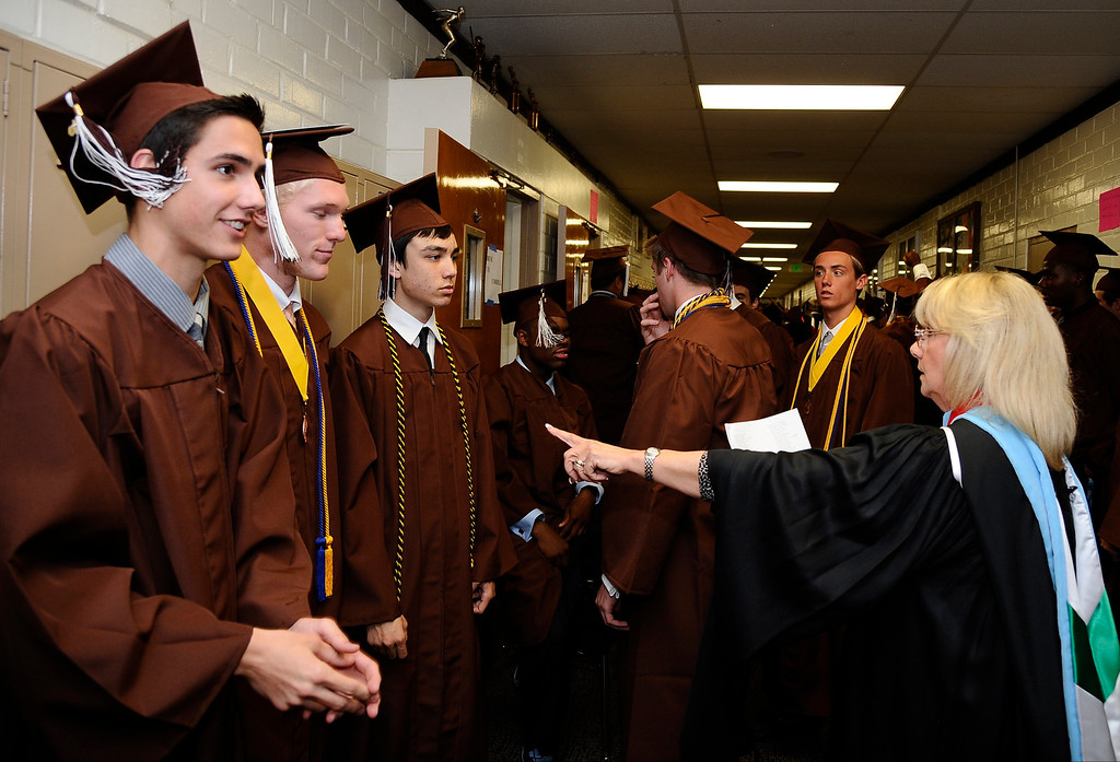 . Director of counseling Sharon Barkins gets the grads in order during the Crespi High class of 2013 graduation. May 24.2013.  Photos by Gene Blevins/LA DailyNews