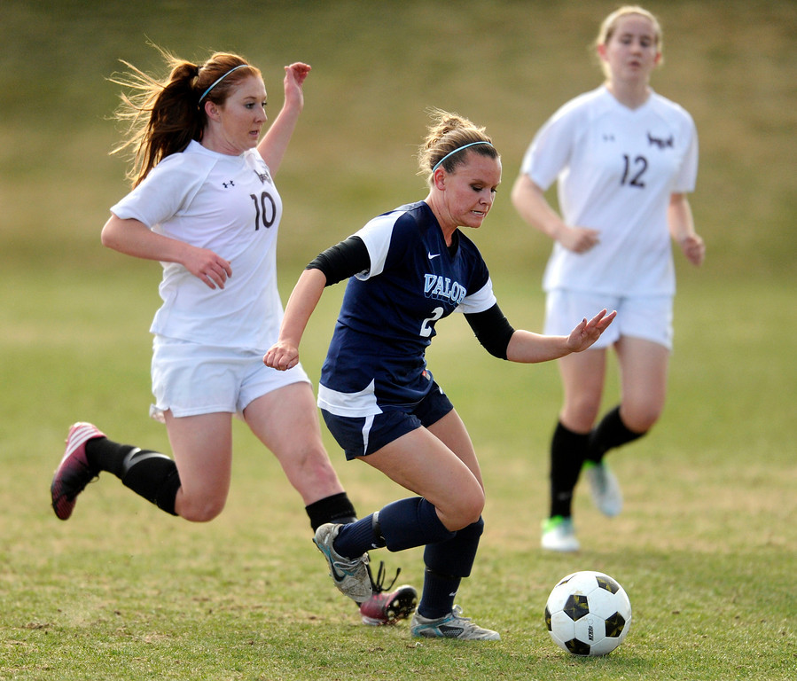 . PARKER, CO. - APRIL 2: Valor senior midfielder Rachael Collins (2) worked between Golden\'s Mariah Fluitt (10) and Emily Oltmans (12) in the first half. The Valor Christian High School girl\'s soccer team defeated Golden 4-1 Wednesday night, April 3, 2013.  Photo By Karl Gehring/The Denver Post)
