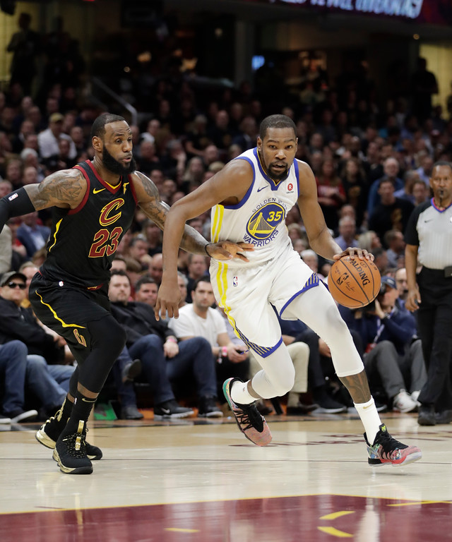 . Golden State Warriors\' Kevin Durant goes to the basket against Cleveland Cavaliers\' LeBron James in the first half of Game 4 of basketball\'s NBA Finals, Friday, June 8, 2018, in Cleveland. (AP Photo/Tony Dejak)