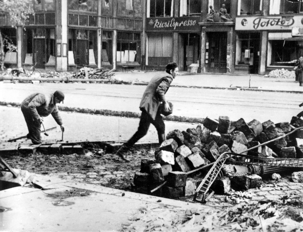 . 1956: The Hungarian freedom fighter. For their desperate resistance in the streets of Hungarian capital Budapest, freedom fighters tear up a street to errect barricades with cobble stones, November 4, 1956. Only the deployment of artillery and war planes broke the resistance of the poorly armed Hungarian rebels against the communist regime. (AP Photo/STF)