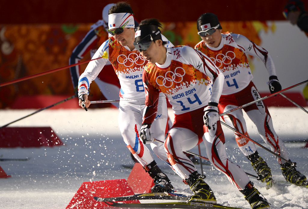 . France\'s Francois Braud (8-L), Japan\'s Hideaki Nagai and team mate Taihei Kato compete in the Nordic Combined Individual NH / 10 km Cross-Country at the RusSki Gorki Jumping Center during the Sochi Winter Olympics on February 12, 2014, in Rosa Khutor near Sochi.   AFP PHOTO / PIERRE-PHILIPPE MARCOU/AFP/Getty Images