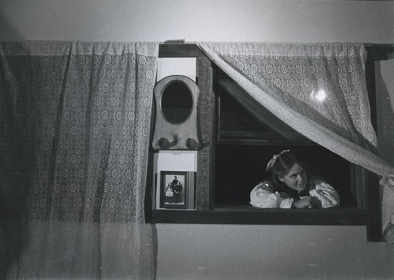 1980 - Brett Hall peeking through window in nightgown, on set?.jpeg