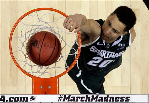 . Michigan State\'s Travis Trice (20) dunks against Virginia during the first half of an NCAA tournament college basketball game in the Round of 32 in Charlotte, N.C., Sunday, March 22, 2015. Michigan State won 60-54. (AP Photo/Gerald Herbert)