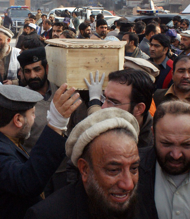 . Pakistani relatives move the coffin of a student from a hospital following an attack by Taliban gunmen on a school in Peshawar on December 16, 2014. Taliban insurgents killed at least 130 people, most of them children, after storming an army-run school in Pakistan December 16 in one of the country\'s bloodiest attacks in recent years. AFP PHOTO/ A  Majeed/AFP/Getty Images