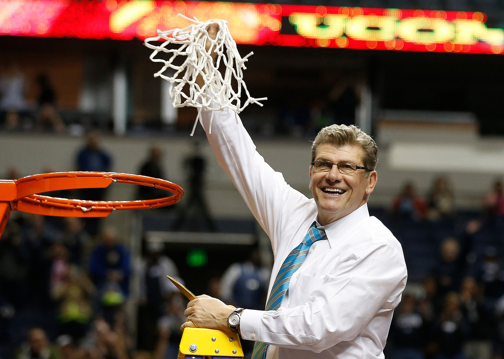 . Connecticut head coach Geno Auriemma holds the net after the second half of the championship game against Notre Dame in the Final Four of the NCAA women\'s college basketball tournament, Tuesday, April 8, 2014, in Nashville, Tenn. Connecticut won 79-58. (AP Photo/John Bazemore)