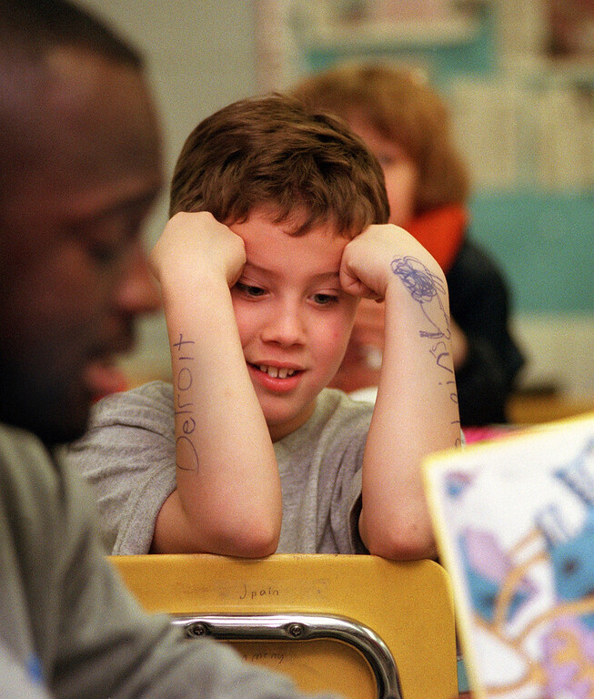 """. David Mikowski, 10,  listens to Detroit Lions running back Sedrick Irvin, reading to Dave Abbott\'s 4th grade class at Pine Tree Elementary School in Lake Orion.  Irvin was reading Dr. Seuss\' \""""Oh, The Places You Will Go.\"""""""