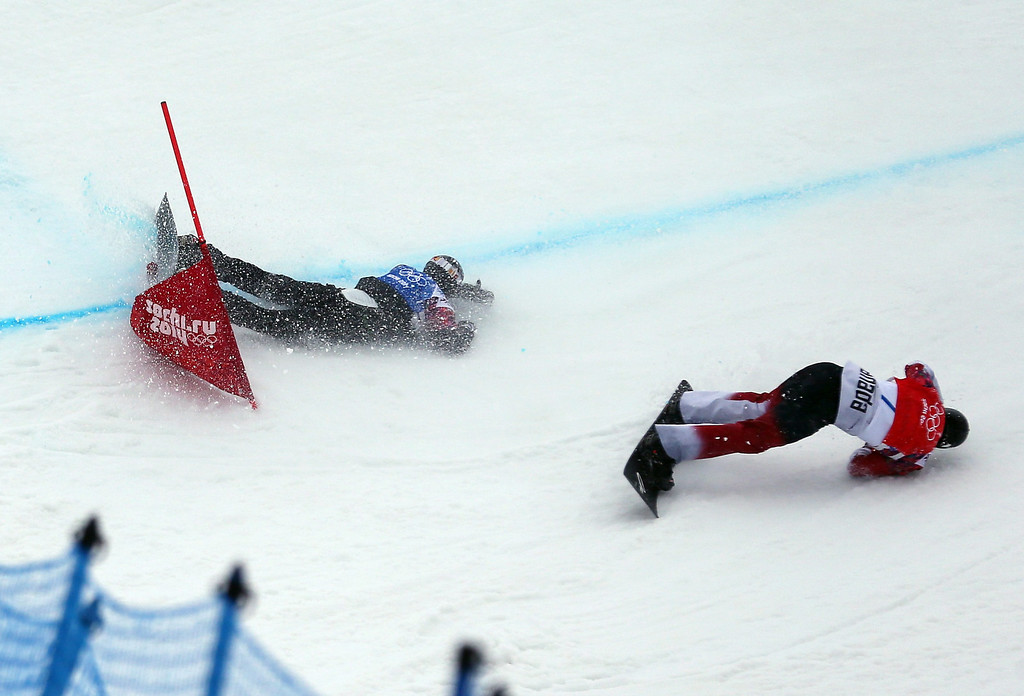. Canada\'s Christopher Robanske (bottom right) collides with German Paul Berg during the fourth quarter final run in the Menës Snowboard Cross at Rosa Khutor Extreme Park at the Sochi 2014 Olympic Games, Krasnaya Polyana, Russia, 18 February 2014.  EPA/SERGEY ILNITSKY