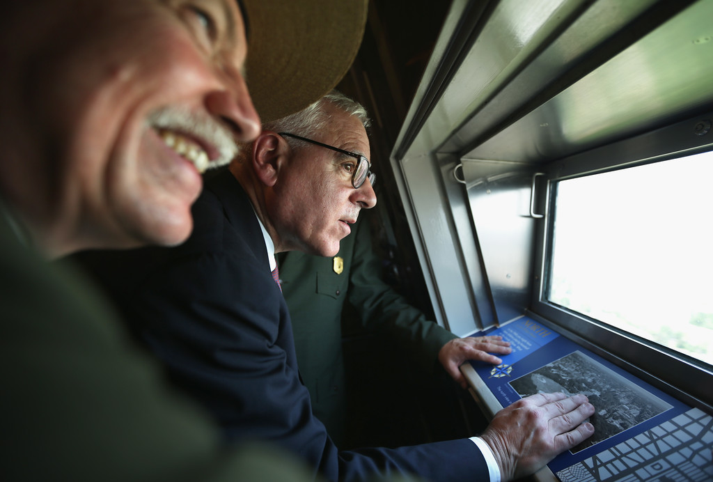 . National Park Service Director Jonathan Jarvis (L), and Co-Founder and Co-CEO of The Carlyle Group David Rubenstein (R) look out of the window at the 500-foot level of the Washington Monument after a reopening ceremony May 12, 2014 in Washington, DC.  (Photo by Alex Wong/Getty Images)