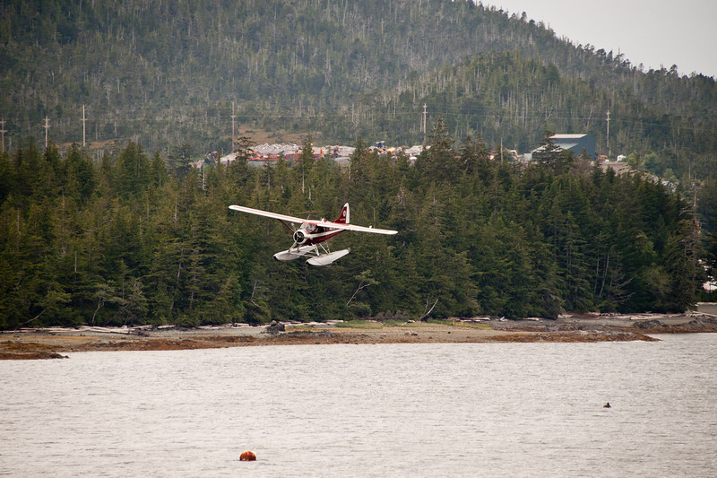 Float plane landing near the airport.