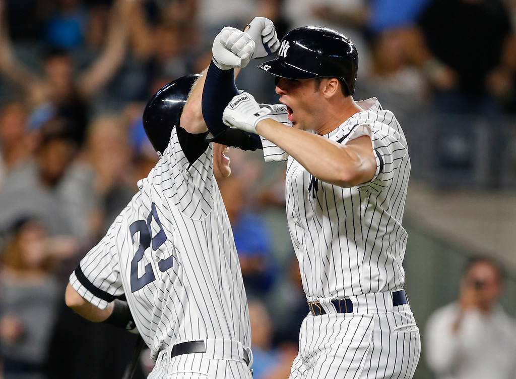 . New York Yankees first baseman Greg Bird, right, celebrates with New York Yankees\' Todd Frazier (29) after hitting a solo home run during the seventh inning against the Cleveland Indians in Game 3 of baseball\'s American League Division Series, Sunday, Oct. 8, 2017, in New York. (AP Photo/Kathy Willens)