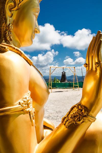 Artistic composition with vivid colors around a golden statue captured at the hill of Big Buddha.