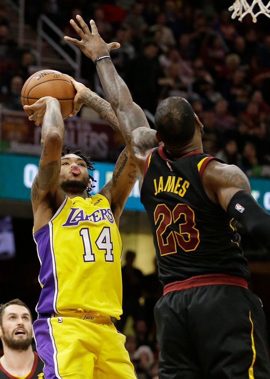 . Los Angeles Lakers\' Brandon Ingram (14) shoots over Cleveland Cavaliers\' LeBron James (23) in the second half of an NBA basketball game, Thursday, Dec. 14, 2017, in Cleveland. (AP Photo/Tony Dejak)