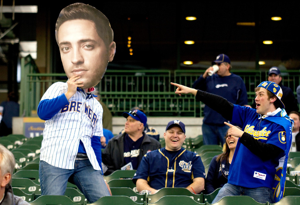 . Hans Felton, with a Ryan Braun cutout, jokes with with Kelly Traska before the an opening day baseball game between the Milwaukee Brewers and Colorado Rockies at Miller Park in Milwaukee on Monday, April 1, 2013. (AP Photo/West Bend Daily News, John Ehlke)