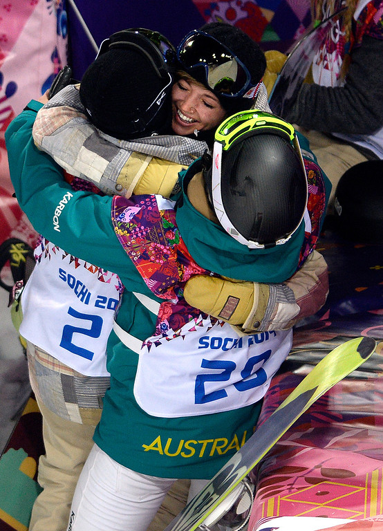 . American gold medalist Kaitlyn Farrington hugs silver medalist Torah Bright of Australia (right) and bronze medalist American Kelly Clark after a women\'s snowboard halfpipe final at the Rosa Khutor Extreme Park. Sochi 2014 Winter Olympics on Wednesday, February 12, 2014. (Photo by AAron Ontiveroz/The Denver Post)