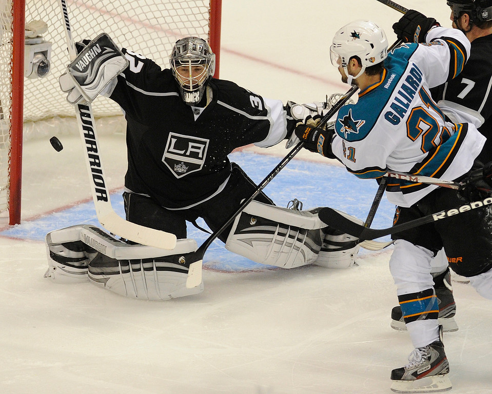 . Kings#32 Jonathan Quick stops a shot by Sharks#21 JT Galiardi in the second period. The Kings played the San Jose Sharks during the first game in the Second Round of the Western Conference Playoffs. Los Angeles CA 5/14/2013(John McCoy/LA Daily News)