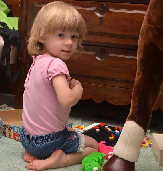 Ella LOVES playing at Mama and Papa's house