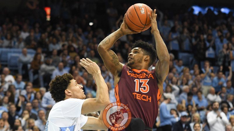 Virginia Tech Hokies guard Ahmed Hill (13) shoots off balanced over North Carolina Tar Heels forward/guard Justin Jackson (44). (Michael Shroyer/ TheKeyPlay.com)