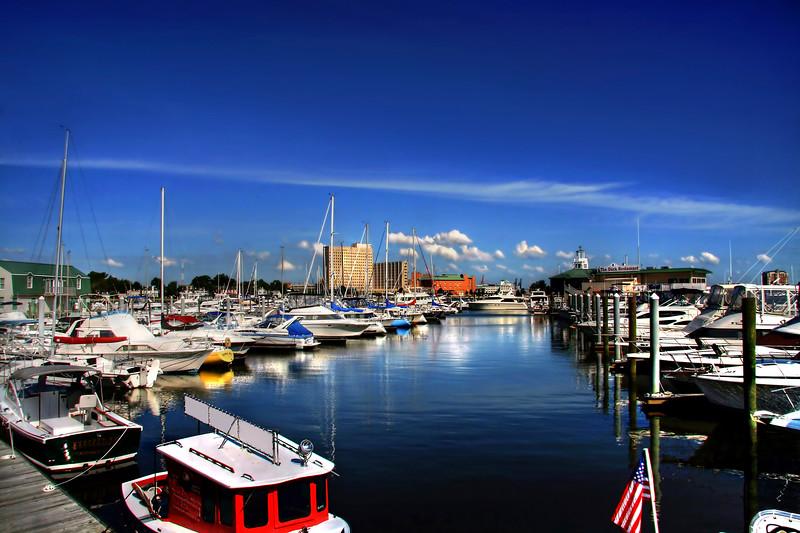 Beautiful marina that harbors small yachts and sailboats.