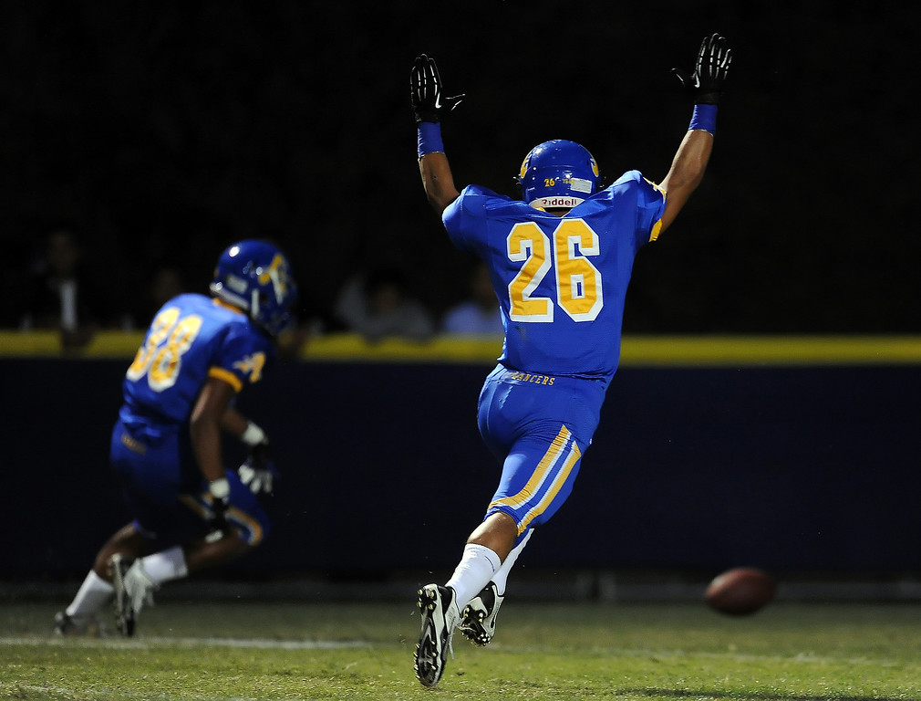 . Bishop Amat\'s Aaron Austin (38) dives on a football in the end zone for a touchdown after blocking a Charter Oak punt as Gabriel Perez (26) reacts in the first half of a prep football game at Bishop Amat High School in La Puente, Calif. on Friday, Sept. 20, 2013.    (Photo by Keith Birmingham/Pasadena Star-News)