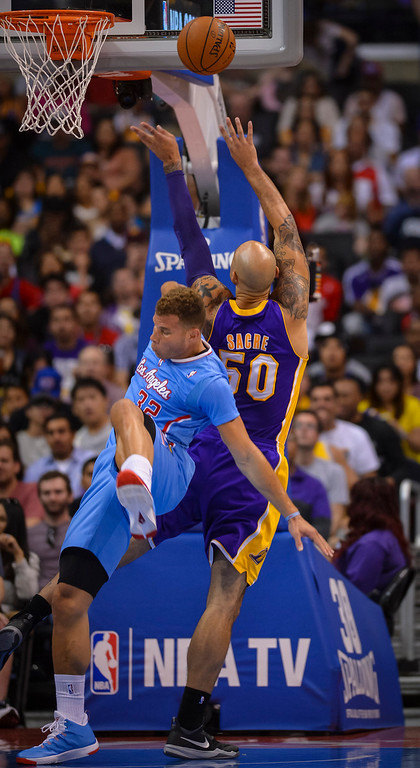 . Clippers Blake Griffin falls on Lakers� Robert Sacre during game action at Staples Center Sunday April 6, 2014. Clippers defeated the Lakers 120-97.  ( Photo by David Crane/Los Angeles Daily News )