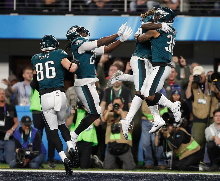 . Philadelphia Eagles\' Corey Clement, right, celebrates his touchdown catch during the second half of the NFL Super Bowl 52 football game against the New England Patriots Sunday, Feb. 4, 2018, in Minneapolis. (AP Photo/Jeff Roberson)