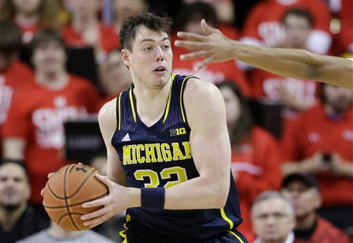 . Michigan forward Ricky Doyle protects the ball from Maryland guard Richaud Pack in the second half of an NCAA college basketball game, Saturday, Feb. 28, 2015, in College Park, Md. (AP Photo/Patrick Semansky)