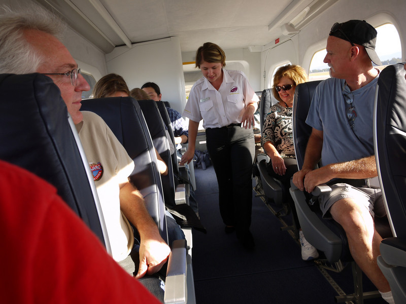 """Getting situated in the 14 passenger """"every seat a window seat"""" cabin."""