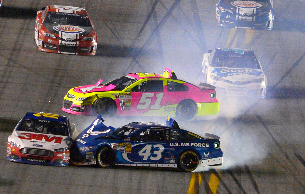 . Greg Biffle (16), Aric Almirola (43) and A J Allmendinger (51) collide after coming out of Turn 4 during the NASCAR Sprint Cup auto race at Daytona International Speedway in Daytona Beach, Fla., Saturday, July 6, 2013. (AP Photo/Phelan M. Ebenhack)