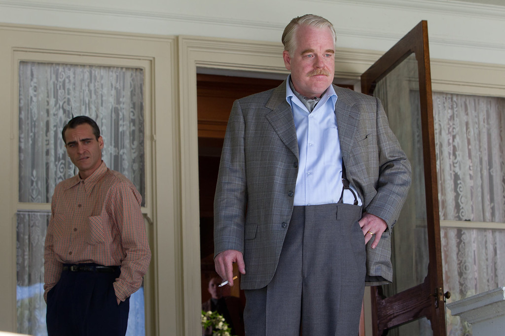 """. This file film image released by The Weinstein Company shows Joaquin Phoenix, left, and Philip Seymour Hoffman in a scene from \""""The Master.\"""" Police say Phillip Seymour Hoffman was found dead in his New York City apartment Sunday, Feb. 2, 2014. He was 46.  (AP Photo/The Weinstein Company, File)"""