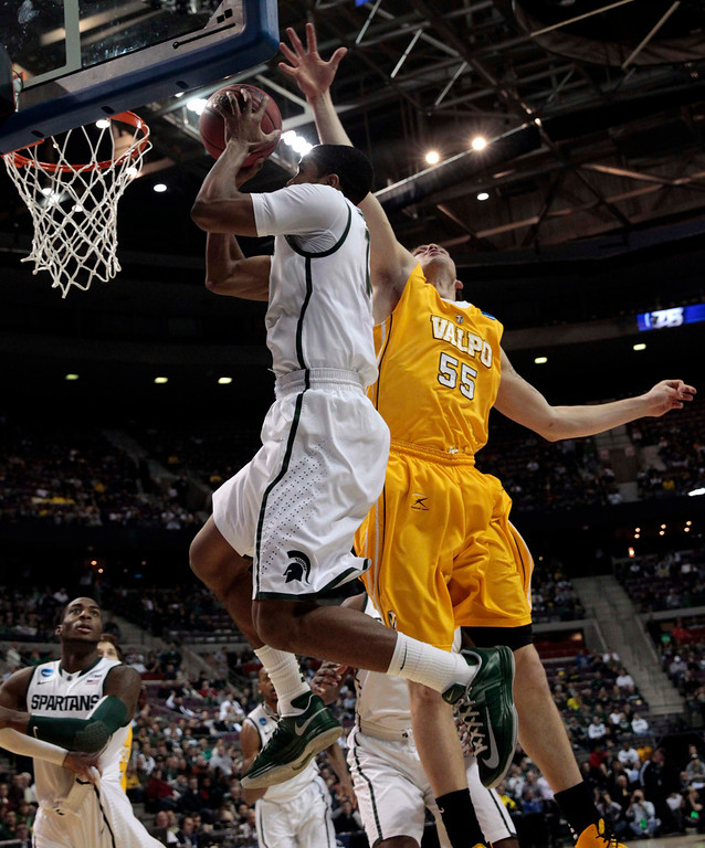 . Michigan State Spartans\' Gary Harris shoots over Valparaiso Crusaders\' Kevin Van Wijk during the first half of their second round NCAA tournament basketball game in Auburn Hills, Michigan March 21, 2013. REUTERS/Jeff Kowalsky