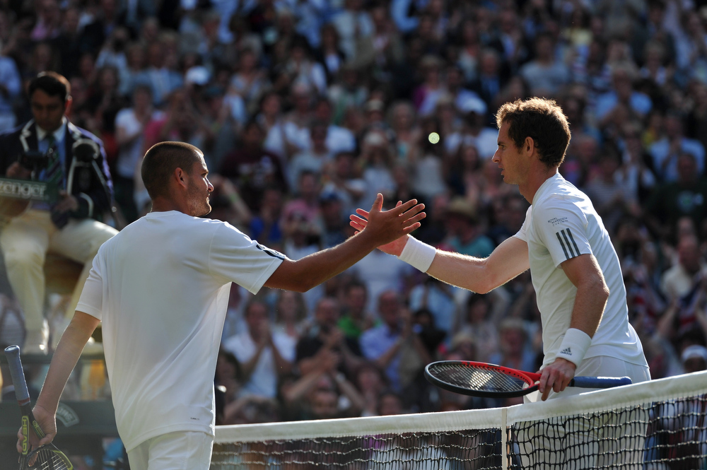 . Britain\'s Andy Murray (R) shakes hands with Russia\'s Mikhail Youzhny (L) after Murray won their fourth round men\'s singles match on day seven of the 2013 Wimbledon Championships tennis tournament at the All England Club in Wimbledon, southwest London, on July 1, 2013. Murray won 6-4, 7-6, 6-1. CARL COURT/AFP/Getty Images