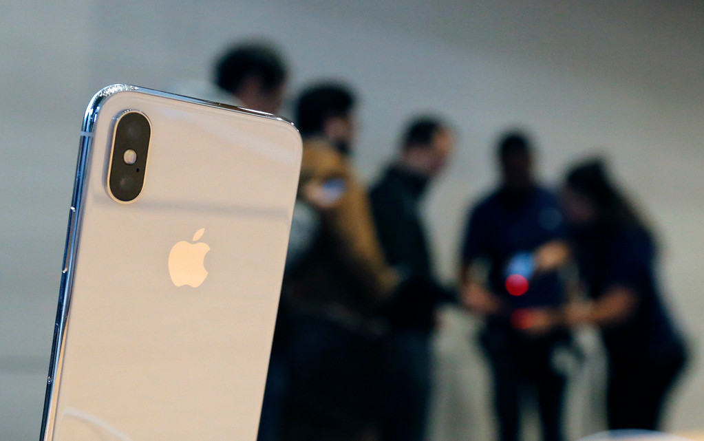 . The new Apple iPhone X sits on display as consumers line up to buy the phone at the new Apple Michigan Avenue store along the Chicago River Friday, Nov. 3, 2017, in Chicago. (AP Photo/Charles Rex Arbogast)