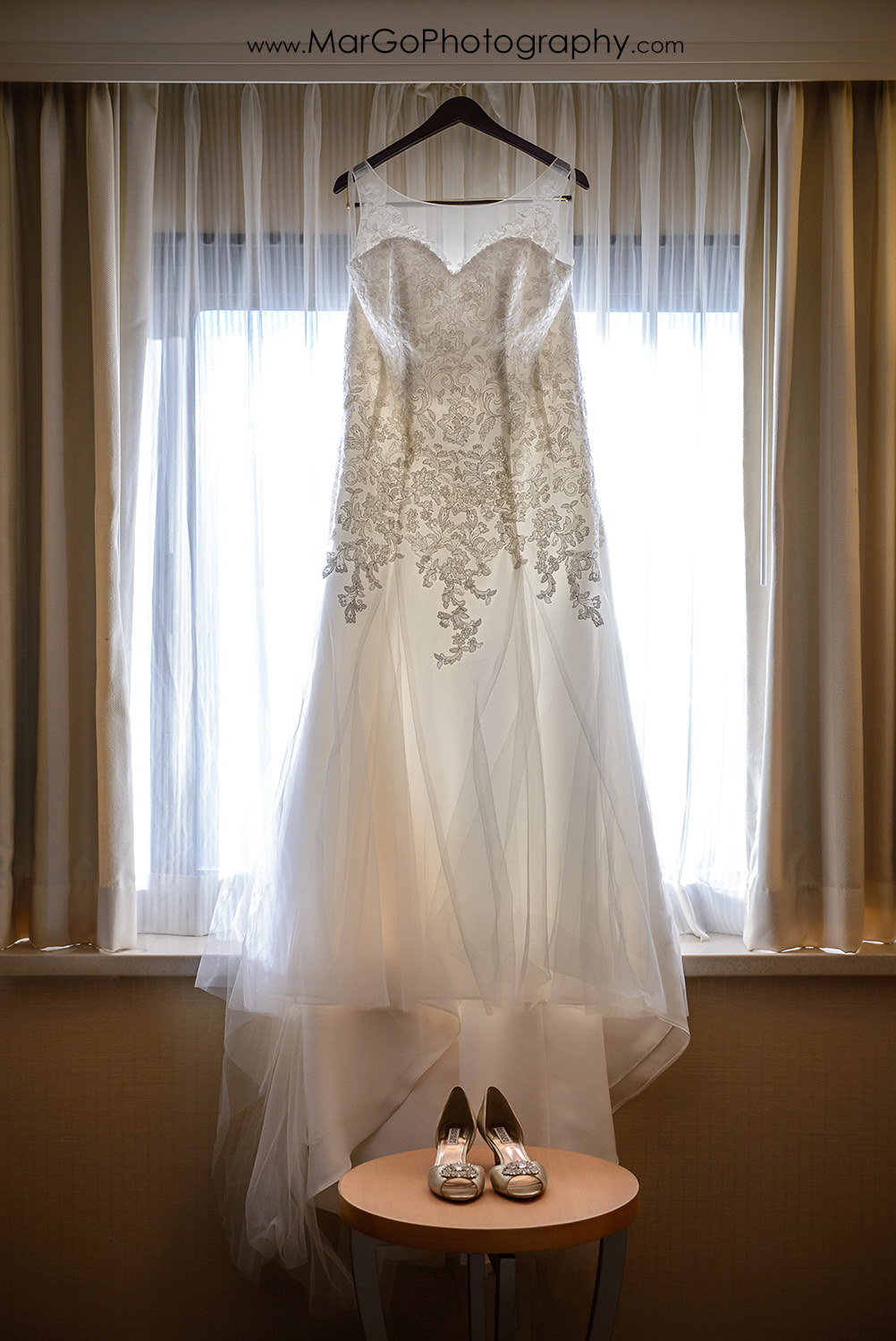 wedding dress and shoes at Hilton San Francisco Airport Bayfront in Burlingame